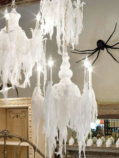 Spiderweb Chandelier:  Drape a chandelier in shredded strips of cheesecloth to create wraithlike forms above a dining table, making sure the strips avoid contact with bulbs to prevent the risk of fire.
