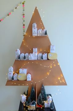 Advent calendar tree - paint a Christmas tree on the wall and add small shelves in the same color to hold the countdown boxes Christmas Wreath Image, Diy Christmas Tree, Christmas Love, Christmas Countdown, All Things Christmas, Winter Christmas, Christmas Decorations, Holiday Decor, Xmas