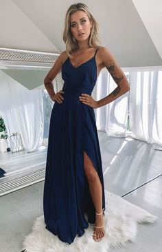 Be the belle of the ball in the Katrina Split Maxi Dress Navy. This gorgeous maxi dress is the perfect combination of elegance and class. Wear it to your next special event with gold accessories, strappy heels and a clutch. Navy Dress Outfits, Glam Dresses, Dance Dresses, Maxi Dresses, Year 10 Formal Dresses, Green Formal Dresses, Dress Red, Formal Dress Shops, Evening Party Gowns