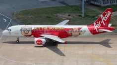 AirAsia (MY) Airbus A320-214 9M-AFL aircraft, painted in Skyrider Club'' special colours Sep. 2012, with the csticker ''Ace the Skyrider !'' on the airframe, skating at Vietnam Ho Chi Minch City Tan Son Nhat International Airport. 24/04/2014. (Skyrider=a Japanese television series).