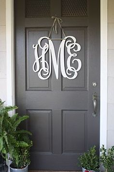 10 of the Prettiest Front Doors as seen in The Prettiest Front Doors - Front Door Ideas - Front Door Porch, Front Door Decor, House Front, Front Door Monogram, Dark Grey Front Door, Gray Front Door Colors, Colored Front Doors, Exterior Colors, Exterior Paint