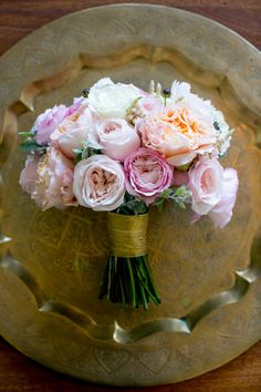 A beautiful bouquet with gold accents and pretty pinks!  View the full gallery here: http://thedailywedding.com/2015/11/14/sweet-urban-wedding/
