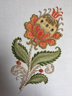 Ornate flower, Silk long and short stitch, goldwork, stumpwork, pearls, beads, check purl. Size: fits A4. Made by Larissa Borodich.