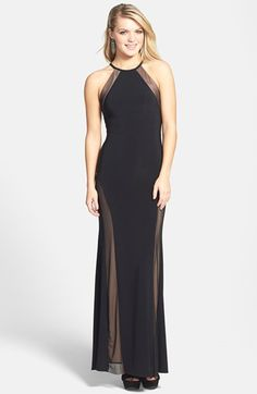 Morgan & Co. Illusion Halter Gown (Juniors) at Nordstrom.com. A slim halter neckline begins a flattering, sleek gown that keeps the allure alive with flirtatious illusion panels and a striking back keyhole.