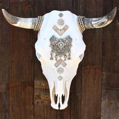 Child of Wild Decorated Cow Skull Femme Adorned with Antique and New Rhinestone Jewelry Broken Apart Placed Around Each Horn Large Rhinestone Center Piece With Shell and PeaDetailsals Inspired by haut