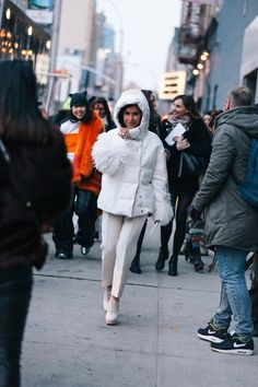 We just want to hug Mira Duma in her ice white padded coat.
