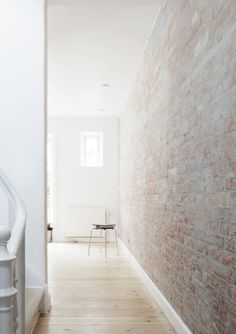 We love the exposed brick wall and lightness of space. Clean and contemporary. | residential design; interior design; photography; architecture; modern; industrial | MINTY WARES | VIA - These things take time