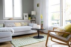 Interior,Impressive Scandinavian Living Room Design Ideas With White And Grey Wall Paint And Wooden Flooring Featuring Sliding Glass Doors And Black Round Coffee Table And Complete With White Sofabed And White Drum Shade Floor Lamp,Lovely Scandinavian Living Room Interior Design Inspirations
