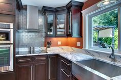 Dark Cabinet Gallery. At Wood Cabinet Factory, we offer the highest quality wood kitchen cabinets at the lowest prices - guaranteed. Visit us on US Highway 46, Fairfield, NJ.