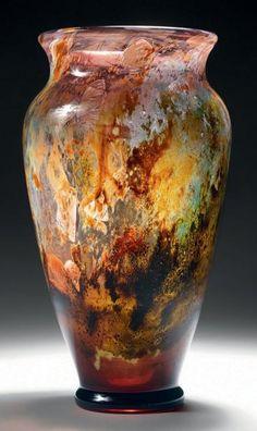 """Émile GALLÉ (1846-1904)  Vase conique sur petit talon débordant à épaulement renflé et col évasé en marqueterie de verre et d'oxydes intercalaires. Décor de papillons et d'une libellule entièrement ciselé. Signé et numéroté """"18"""" sous le talon. Hauteur: 23,8 cm - Diamètre à l'épaulement: 11,2 cm Provenance: collection personnelle d'Émile Gallé, resté dans sa descendance"""