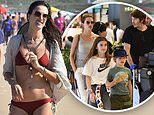 Alessandra Ambrosio rocks a red bikini on the beach before heading to the airport in Brazil