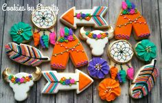 Decorated sugar cookies for a young and wild third birthday party. Boho, southwestern, arrows, cow skulls, dream catchers, teepees, royal icing, girly, colorful