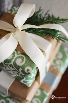 Green and white wrapping paper is taken up a notch with burlap and spruce.
