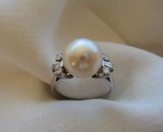 SALE Circa 1970's 1170mm Pearl Ring by camelliacollection on Etsy, $2950.00