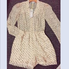 BCBG generation long sleeve chiffon romper Oh so adorable romper with open back. Lined shorts...chiffon patterned material. Super cute and brand new w tags! Never worn. Just found in my closet! Long sleeves with button cuffs. Beige with brown and black. Purchased full price at Bloomingdales.....make an offer  BCBGeneration Other