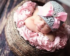 Crochet baby girl hat with ribbon and rhinestone button.