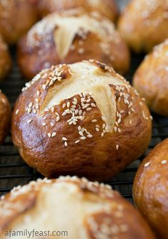 Soft Honey Sesame Pretzel Rolls - It's easy to make these delicious soft honey sesame pretzel rolls at home!