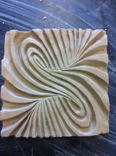 5x5 ceramic tile, relief carving. This is complex but the idea of mixing op art and clay tiles is interesting.....