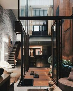 The Inverted Warehouse-Townhouse is designed by Dean-Wolf Architects and is located in // Photos by Paul Warchol - Architecture and Home Decor - Bedroom - Bathroom - Kitchen And Living Room Interior Design Decorating Ideas - Architecture Design, Building Architecture, Contemporary Architecture, Architecture Courtyard, Paris Architecture, Contemporary Houses, Architecture Interiors, Modern Interiors, Sustainable Architecture