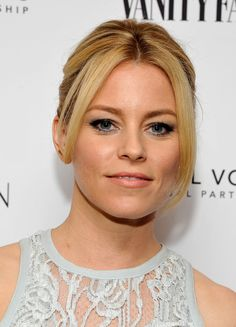 Elizabeth Banks Retro Updo - Elizabeth Banks attended the Vanity Fair and Stuart Weitzman luncheon wearing her hair in a '60s-inspired updo.