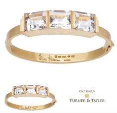 Elegant matte #18karat #gold #bangle #bracelet with 3 side by side emerald cut #whitetopaz #striking and #bold and very #unique available at Turnerandtatler.com