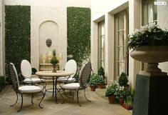 Small but elegant courtyard. A good example of how even a small enclosed courtyard, can still look beautiful & interesting.