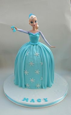Frozen Elsa Doll Cake- add a lei and flower in her hair for frozen luau theme.