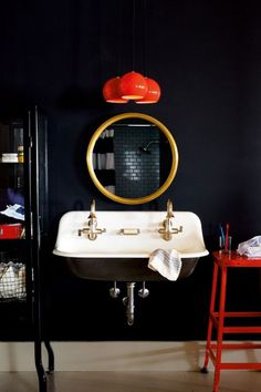 Chic black and gold Bathroom with double sink and  red pendant lights. #blackbathroom #bathroom #roundmirror
