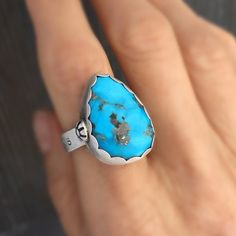 She who dares wins ring. This is a Nacozari turquoise that is found in Sonora Mexico south of Bisbee Arizona in the same mountain range. The color is an amazing blue color and desired for that reason. It's really eye catching