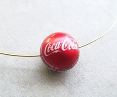 Picture of How to Make a Bottle Cap Bead. Picture of How to Make a Bottle Cap Bead. The post Picture of How to Make a Bottle Cap Bead. appeared first on Craft Ideas. Bottle Cap Jewelry, Bottle Cap Art, Bottle Top, Bottle Cap Bracelet, Bead Bottle, Bottle Cap Earrings, Diy Bottle, Bottle Stopper, Bottle Cap Projects