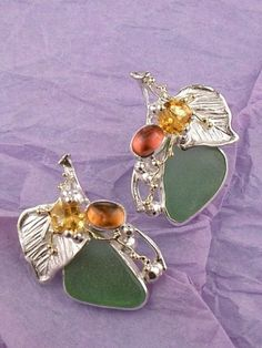 pinned from http://www.designerartjewellery.com/seaglassjewelry.htm Earrings with seaglass, tourmline cabochons, and faceted citrine