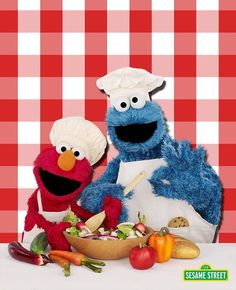 Elmo and Cookie Monster are making a healthy lunch! Hey, what's that Cookie Monster has in his pocket?