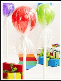 Take PVC piping, a balloon, and plastic wrap to create giant lollipops..                   STEPS:  1. Take the piping and place it on a hard/ flat surface  2. Take the balloon and wrap (Like you see above) and tie it to the top of the pipe  3. Enjoy the project and tell me how it goes!!   4. Thanks and don't forget to follow me!! ⭐❤