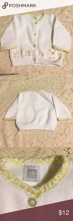 Carter's newborn sweater. NWOT Carter's newborn sweater. NWOT. White cotton. Flower pearly buttons. Fabric trim at neckline. Sheep and flowers embroidered at bottom. Carter's Jackets & Coats
