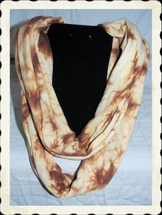 Beautiful brown tie dye infinity scarf. Scarf measures 25 inches long.