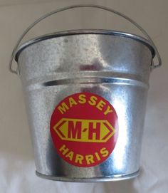 "NEW  ""MASSEY-HARRIS LOGO"" GALVANIZED PAIL LOGO USED FROM 1930-1957"