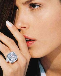 e stone is 'Asscher cut', which is a modern emerald cut that leans towards square rather than rectangular. It weighs 21.46 carats,