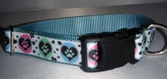 Paws are centered in gently colorful hearts surrounding this collar. A soft design yet colorful enough to stand out in the crowd.     Backed with nylon webbing for strength and durability.    A black buckle and adjustment glide are complimented with a metal D ring.     If you would like this collar in another size or style, please message or email us and we will be happy to create the collar to your liking. | Shop this product here: http://spreesy.com/AllPawstive/167 | Shop all of our…