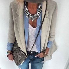 Chic business attire, work outfit, thick silver statement necklace and button shirt