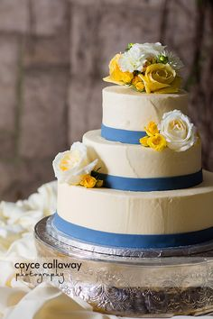 A yellow and blue themed wedding cake for a country wedding