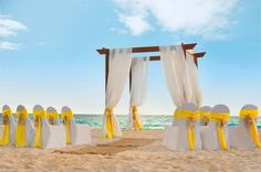 Love the pop of color at the beach ceremony. Hilton Barbados