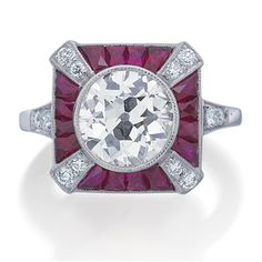 Platinum and ruby estate-inspired semi-mount ring with 0.20 tcw round brilliant diamonds and precision french carre cut rubies.