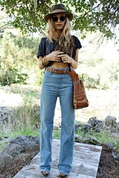 High wasted light jeans (a better kind than these, but the idea is there.) Belly shirt (out of plain T, or 70's mod mattern.) Hat, brown side purse with fringe.