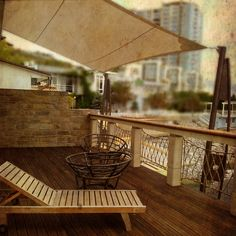 sun shade, wooden floor & rope railings