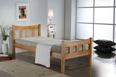 This Bonsoni Simple Style Single Miami Bed Frame Pine is a beautiful piece of Bed demostrating the Bonsonis unparallel quality and workmanship. This MIAMI BED PINE comes in 2 boxes. This Bonsoni Simple Style Single Miami Bed Frame Pine is mad Pine Bed Frame, Wooden Bed Frames, Single Wooden Beds, Home Bedroom Design, Kids Bedroom, Simple Bed Frame, Leather Bed Frame, Pine Beds, Ottoman Storage Bed
