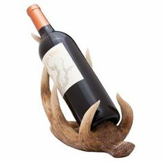 """Bottle holder with an antler-inspired silhouette.  Product: Wine bottle holderConstruction Material: PolystoneColor: NaturalFeatures: HandcraftedDimensions: 7.48"""" H x 4.72"""" W x 10.63"""" D"""
