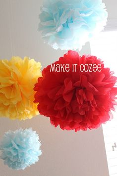 Dr. Suess Birthday Party DIY paper pom poms  -hang for decorations  -try tissue paper tip in comment box  *teal *red *yellow/green