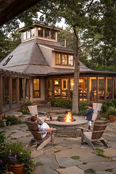 Stone firepit. Woodsy backyard with Stone firepit and stone patio. Stone firepit. Stone firepit ideas #Stonefirepit #Backyard Sullivan + Associates Architects Micoleys picks for #OutdoorLiving www.Micoley.com
