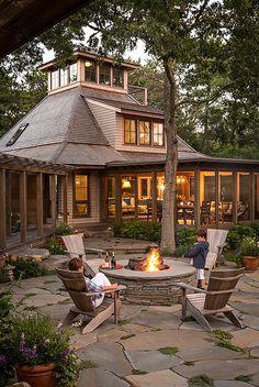 Stone firepit. Woodsy backyard with Stone firepit and stone patio. Stone firepit. Stone firepit ideas #Stonefirepit #Backyard Sullivan + Associates Architects
