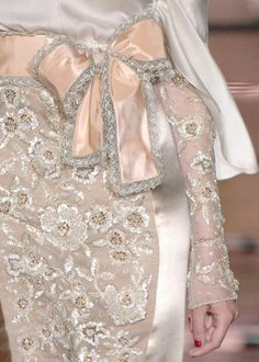 Amazing bow detail on this pink dress
